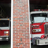 ALLEGRA BOVERMAN/Staff photo. Gloucester Daily Times. Gloucester: <br /> Lawrence Ladder 4, left, is a ladder truck being lent to the GLoucester Fire Department by the Lawrence Fire Department. The truck is parked at the West Gloucester Fire Station.