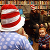 "Mario Zanetti, 18 months, of Manchester, excitedly stumbles toward Sara Collins, children's librarian at Manchester Public Library, as she reads ""Happy Birthday To You"" by Dr. Suess in celebration of the author's birthday on Friday morning. Jesse Poole/Gloucester Daily Times March 2, 2012"