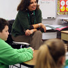 "ALLEGRA BOVERMAN/Staff photo. Gloucester Daily Times. Gloucester: G<br /> O'Maley Middle School Principal Deb Lucey read ""The Other Side,"" with fifth graders at Veterans Memorial Elementary School on Friday. About 13 ""local celebrities"" were on hand to read to every classroom in the school. She also talked with them about what to expect in sixth grade."