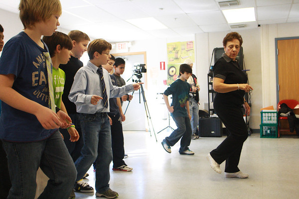 Local dance instructor Tina LaFlam visits Beeman Elementary School on Wednesday morning and teaches a group of fifth grade boys how to dance. This was part of special ballroom dancing lessons that will be taking place at a number of schools in the city. . Jesse Poole/Gloucester Daily Times March 6, 2012
