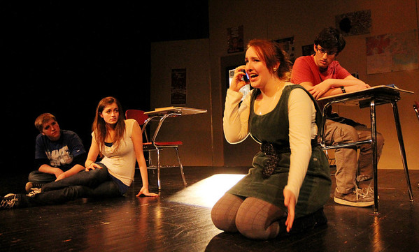 """ALLEGRA BOVERMAN/Staff photo. Gloucester Daily Times. Gloucester: During a rehearsal of """"Lockdown,"""" the one act play that Gloucester High School Drama Club students are performing during the upcoming 2012 Massachusetts Drama Festival competition this weekend. From right to left are: Zach Schultz, Zoe Paddock, Kelly O'Dea and Ryan Hull."""
