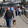 ALLEGRA BOVERMAN/Staff photo. Gloucester Daily Times. Gloucester: People meet and mingle along Stacy Boulevard on a mild, sunny and breezy Monday afternoon in Gloucester.