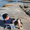 Gloucester: Asi Texeira who is visiting from Boston had Wingaersheek Beach Gloucester Monday morning as she enjoyed a day off to get some sun and write in her journal. Jim Vaiknoras photo