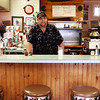 GLOUCESTER—David Tucker, owner of Tucker's Farm Family Dinner at 67 Maplewood Ave., stands behind the counter on Wednesday afternoon for what will be one of his last days to do so, as the cozy restaurant is closing at the end of this coming weekend. Jesse Poole/Gloucester Daily Times March 14, 2012