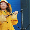 Third-grader Morgan McGuire wears fishermen's clothing and holds an anchor in front of the third, fourth and fifth graders of West Parish School as Schooner Adventure sponsors an educational outreach program about the history of Gloucester. Jesse Poole/Gloucester Daily Times March 16, 2012