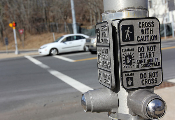 ALLEGRA BOVERMAN/Staff photo. Gloucester Daily Times. Gloucester: A pedestrian crossing button at the exact spot in the intersection of Route 128 and Eastern Avenue adjacent where a man was hit by a car earlier this week.