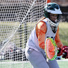 ALLEGRA BOVERMAN/Staff photo. Gloucester Daily Times. Gloucester: Manchester-Essex Girls Varsity Lacrosse goalie Maddie Bistrong in action during practice on Tuesday afternoon at Field Field in Manchester.