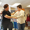 Guest dance instructor Tina LaFlam uses Trevor Parisi's new dance skills to show Annemarie Wentzell's fifth grade class how to dance the right way on Wednesday morning at Beeman Elementary School. Jesse Poole/Gloucester Daily Times March 6, 2012