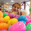 ALLEGRA BOVERMAN/Staff photo. Gloucester Daily Times. Gloucester: Christine Orlando, owner of Kids Unlimited and a member of Gloucester Downtown Association, with 1,000 Easter eggs that will be distributed during the Easter Egg Run on April 7 downtown.