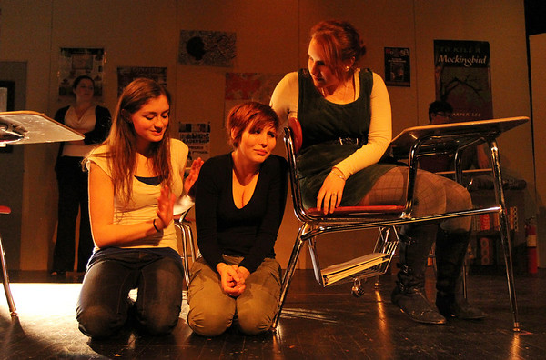 """ALLEGRA BOVERMAN/Staff photo. Gloucester Daily Times. Gloucester: During a rehearsal of """"Lockdown,""""  the one act play that Gloucester High School Drama Club students are performing during the upcoming 2012 Massachusetts Drama Festival competition this weekend. From left are: Kelly O'Day, Amberly Moody and Zoe Paddock. Back left is Kate Parisi."""