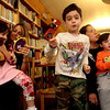 "ALLEGRA BOVERMAN/Staff photo. Gloucester Daily Times. Manchester: Listening to ""The Story of Esther,"" at the Manchester Public Library on Tuesday are, from left: Skyler Hough, 5, and her mother Jennifer Ware-Hough, both of Essex, Josh Cohen, 5, his mom Jenai Cohen and brother Noah, 2, of Manchester.  The participants used noisemakers every time the name of the story's bad guy, Haman, was mentioned, and when Queen Esther's name was spoken, all would say ""Ohh, lala!"" and when her uncle Mordechai's name was mentioned, they would say ""Hip Hip Hooray!"" The Robert I Lappin Charitable Foundation of Salem sponsored the free program at the library. Children also had hamentashen, which are triangle-shaped cookies filled with preserves, and made little baskets to bring treats to neighbors and friends for the holiday, which starts Purim begins in the evening of Wednesday, March 7, 2012, and ends in the evening of Thursday, March 8, 2012."