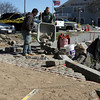 "ALLEGRA BOVERMAN/Staff photo. Gloucester Daily Times. Gloucester: Workers from Cape Ann Stone of Rockport work on the Harborwalk at the <br /> John ""Gus"" Foote Park on Friday."