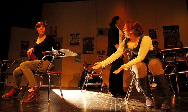 """ALLEGRA BOVERMAN/Staff photo. Gloucester Daily Times. Gloucester: During a rehearsal of """"Lockdown,"""" the one act play that Gloucester High School Drama Club students are performing during the upcoming 2012 Massachusetts Drama Festival competition this weekend. From left are: Amberly Moody and Zoe Paddock. Behind them are, from left: Kate Parisi, Zach Schultz and Kelly O'Dea."""