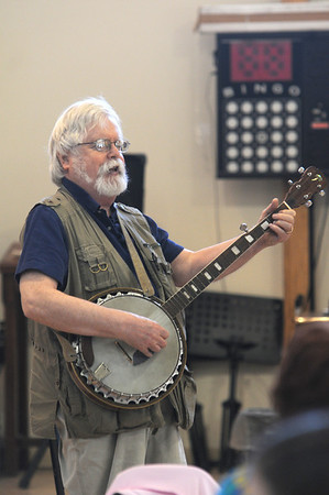 Gloucester:Roger Hussey play the MTA song on the banjo at the spring kick off intergenerational talent show at the Rose Baker Senior Center. The event featured, along with banjo, comedy skits , piano, a sing -a -long and lots of fabulous entertainment. Jim Vaiknoras/staff photo