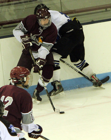 ALLEGRA BOVERMAN/Staff photo. Gloucester Daily Times. Chelmsford: Rockport lost  6-2 to Bedford at the Chelmsford Forum Ice Arena on Thursday night. Rockport's Josh Guertin, top, in action with teammate Alex Amoroso, lower left, against Bedford.