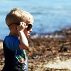 Andy Russel, 2, sports a pair of sunglasses as he visits Back Beach in Rockport with a large group of friends from Newton on a sunny Thursday monring. Jesse Poole/Gloucester Daily Times March 22, 2012