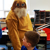 The Lorax speaks with his student Nathan Duda on Friday morning. Joe McDonough, fifth-grade teacher at Manchester Memorial Elementary School, dresses as the Dr. Suess character in celebration of Read Across America and the author's birthday on Friday. Jesse Poole/Gloucester Daily Times March 2, 2012