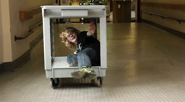 ALLEGRA BOVERMAN/Staff photo. Gloucester Daily Times. Rockport: While helping out after school on Friday before a school dance, Gus Johnson, a third grader at Rockport Elementary School, devised a new sport in the hallway.