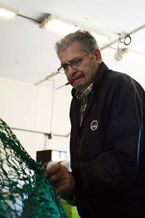 Joe Curcuru, 77, mends nets on Thursday morning in a storage unit at 417 Main Street. Jesse Poole/Gloucester Daily Times March 22, 2012
