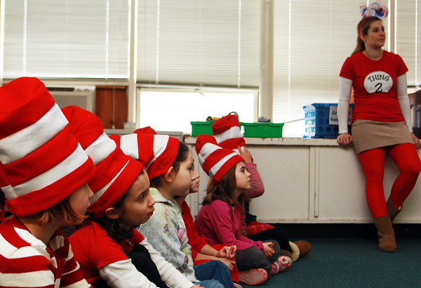 In celebration of Read Across America and Dr. Suess's birthday, Mrs. Decker's kindergarten students watch an educational video about reading and Dr. Suess, while teacher Jenna Seymour, right, supervises on Friday morning at Manchester Memorial Elementary School. Jesse Poole/Gloucester Daily Times March 2, 2012