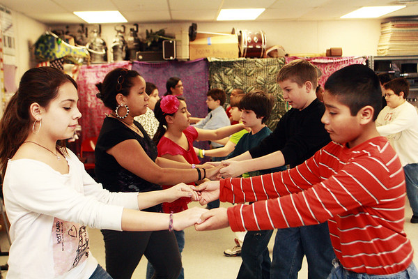 A group of fifth grade students learn how to dance at Beeman Elementary School on Wednesday morning as part of a speacial ballroom dance lesson led by local dance instructor Tina LaFlam. Jesse Poole/Gloucester Daily Times March 6, 2012