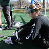 ALLEGRA BOVERMAN/Staff photo. Gloucester Daily Times. Gloucester: Manchester-Essex Girls Varsity Lacrosse co-captain Melissa Moore rolls out her shin splints pain during practice on Tuesday afternoon at Field Field in Manchester.