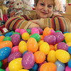 ALLEGRA BOVERMAN/Staff photo. Gloucester Daily Times. Gloucester: Christine Orlando, owner of Kids Unlimited, and a member of the Gloucester Downtown Association, with 1,000 Easter eggs that will be distributed during the Easter Egg Run on April 7 downtown.
