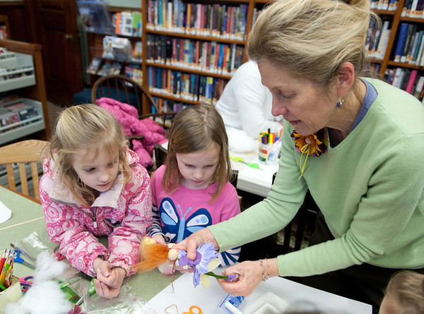 Essex: Elizabeth Rush of Newburyport,Mass (right} helps Olivia Gado 8,and sister Greta 6, put together their Fairy Dolls at the Manchester Public Library Saturday morning. Elizabeth who host these workshops, brings preassembled fairies that young children can put together in about six steps with some help. Desi Smith/ Gloucester Daily Times. March 3,2012.