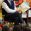 "ALLEGRA BOVERMAN/Staff photo. Gloucester Daily Times. Gloucester: <br /> Richard Safier, Gloucester Schools Superintendent, read to first graders in teacher Anna O'Conner's class at Veterans Memorial Elementary School on Friday. About 13 ""local celebrities"" were on hand to read to every classroom in the school. He was reading ""My Rotten Redheaded Older Brother."""