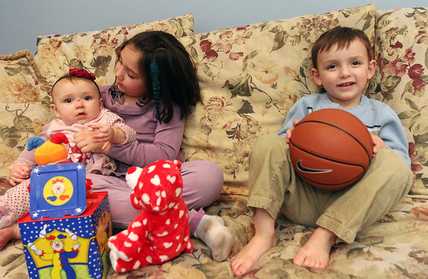 ALLEGRA BOVERMAN/Staff photo. Gloucester Daily Times. Wilmington: Two of the three Vestal family children have urea cycle disorder, a rare disease that they are managing. Michael, 3, at far right, and Marisa, nine months old, far left, who have this condition, playing with their older sister Mia, 7. A benefit will be held for the second year on March 24 that will go towards the National Urea Cycle Foundation.