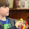 "ALLEGRA BOVERMAN/Staff photo. Gloucester Daily Times. Manchester: <br /> Beren Schmidt, 7, of Manchester works on building a model double helix out of Lego pieces during a Lego DNA workshop at Manchester Public Library on Thursday afternoon. The activity ties in with the medically themed activities at the library all through March that are connected with the Manchester Reads 2012 program centered on ""The Immortal Life of Henrietta Lacks"" by Rebecca Skloot."