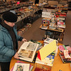 ALLEGRA BOVERMAN/Staff photo. Gloucester Daily Times. Rockport: The Friends of the Rockport Public Library is holding a book sale all weekend at the library on School Street from 10-5 on Saturday and 1-5 on Sunday. From left, Elizabeth Harty of Rockport, Diane Usewick of Gloucester, and in the background, Claudia Haskell of Rockport browse on Friday.