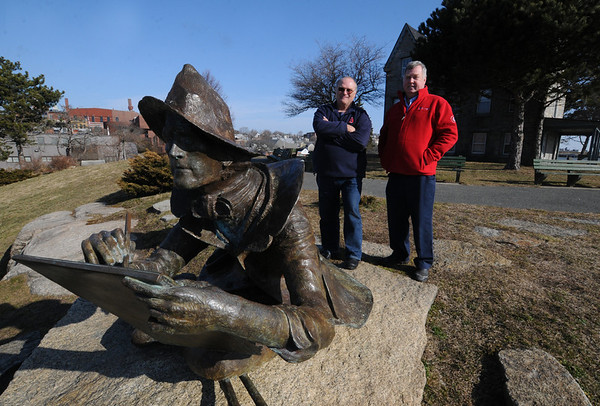 Gloucester: George story, left, and Steve Douglas stand near the statue of artist Fitz Hugh Lane at the Henry Lane house in Gloucester. The two provide narrated walking tours of the city. Jim Vaiknoras/staff photo