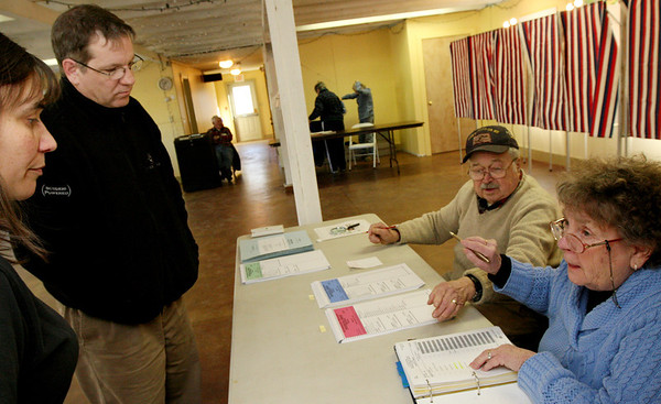 ALLEGRA BOVERMAN/Staff photo. Gloucester Daily Times. Gloucester: Linda and Bill Wrinn, left, check in to vote at the Lanesville Community Center on Super Tuesday. Assisting them at right are polling workers Shirley LaFrance and Paul Harling.