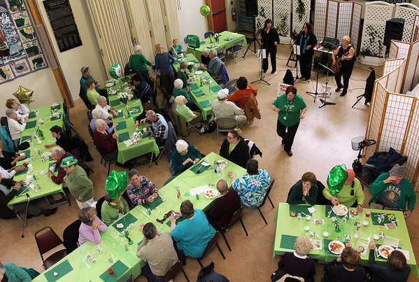 ALLEGRA BOVERMAN/Staff photo. Gloucester Daily Times. Gloucester: During the St. Patrick's Day Party at Rosie's Cafe in the Rose Baker Senior Center on Thursday. There were more than 100 people in attendance.