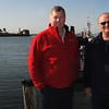 Gloucester: George story, left, and Steve Douglas stand along Gloucester Harbor. The two provide narrated walking tours of the city. Jim Vaiknoras/staff photo