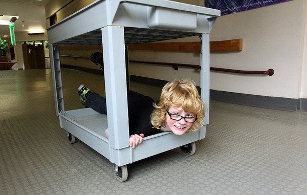 ALLEGRA BOVERMAN/Staff photo. Gloucester Daily Times. Rockport: While helping out  to set up for a school dance after school on Friday, Gus Johnson, a third grader at Rockport Elementary School, devised a new sport in the hallway.
