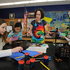 Manchester: Artist Robin Brickman works with students Molly Moore, 8, Maggie Graves,9, and Alex Rosen, 9,at the Manchester memorial Elementary School, as they make 3 dimensional  sea life art that will be part of a Coral Reef Mural that will be displayed at the school. The kids are 3rd graders in Heather Blanchette's class. JIm Vaiknoras/staff photo