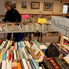 ALLEGRA BOVERMAN/Staff photo. Gloucester Daily Times. Rockport: The Friends of the Rockport Public Library is holding a book sale all weekend at the library on School Street from 10-5 on Saturday and 1-5 on Sunday. Claudia Haskell of Rockport browses on Friday.