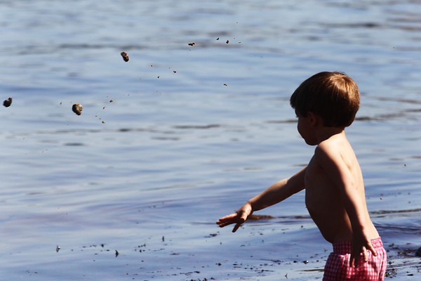 Charlie Daley, 3, of Newton, throws wet sand into the water at Back Beach in Rockport on Thursday morning. Jesse Poole/Gloucester Daily Times March 22, 2012
