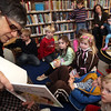 "ALLEGRA BOVERMAN/Staff photo. Gloucester Daily Times. Manchester: Dr. Dorothy Ganick of Manchester, a pediatrician in Lynnfield and a hematology oncology specialist, read stories to children during the story hour at Manchester Public Library on Tuesday afternoon. She read ""Biscuit Visits the Doctor,"" ""ABC Doctor,"" and ""Doctor Maisy."" She also answered questions from the children and showed them a few of her instruments including a stethoscope, otoscope and reflex hammer. The children made their own little doctor's bags afterwards."