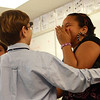 Robby Horne makes Yanila DeJesus laugh as they dance on Wednesday morning at Beeman Elementary School as part of special ballroom dancing lessons for the fifth grade. Jesse Poole/Gloucester Daily Times March 6, 2012