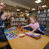 Rockport: Zachary Karcher, 3, and his sister Abigail, 2, play with puzzles and read books at the Rockport Library Friday afternoon. The two hit the books after enjoying the library weekly 10am story hour. JIm Vaiknoras photo<br /> , Rockport: Zachary Karcher, 3, and his sister Abigail, 2, play with puzzles and read books at the Rockport Library Friday afternoon. The two hit the books after enjoying the library weekly 10am story hour. JIm Vaiknoras photo