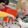 Allegra Boverman/Gloucester Daily Times. Manchester Memorial Elementary School recently celebrated its 100th day of school. On Thursday students were counting to 100 in various ways: from counting Lego pieces to counting flowers. Fifth grader Jackson Ranger, left, and his kindergarten buddy Noah Caress count 100 pennies together.