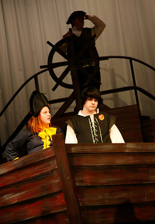 Allegra Boverman/Gloucester Daily Times. From left, below, are Danielle Crear and Joshua Flynn, as Grimsby and Prince Eric, respectively,  in the O'Maley Innovation Middle School's Performing Arts Department production of Disney's Little Mermaid Junior. The pilot, top, is portrayed by Nathaniel Lounsbury. There are two casts for the production.
