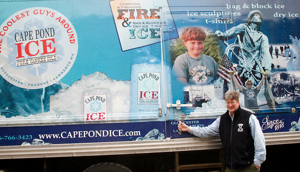 Allegra Boverman/Gloucester Daily Times. Scott Memhard of Cape Pond Ice at the Commercial Street headquarters in Gloucester on Tuesday. He is with one of their highly decorated trucks.