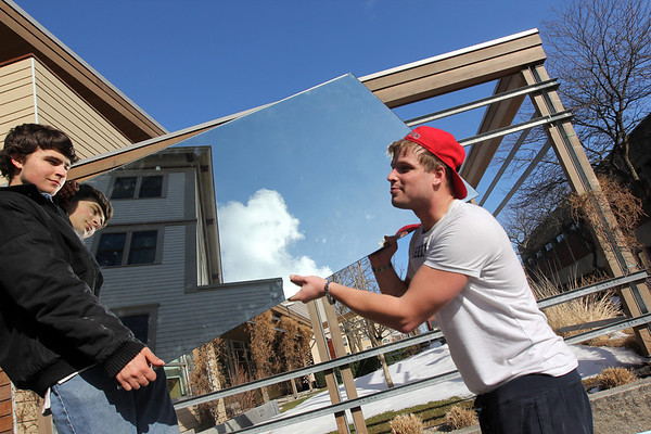 Allegra Boverman/Gloucester Daily Times. Richard Crowell, left, and Brandon Waterman, both of  Gloucester, help move furniture and theater-related things into a new space where Henry Allen's North Shore Folklore Theatre Company will now reside. The group now has new office and practice space in the Cape Ann YMCA Community Center on Middle Street. They just moved in this week and are partnering in some respects with the YMCA, including with theater workshops.