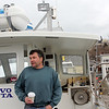 Allegra Boverman/Gloucester Daily Times. Don King, a state permitted fisherman, on his lobster and fishing boat in East Gloucester on Friday.