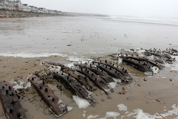 Allegra Boverman/Gloucester Daily Times. The shipwreck known as The Surprise, out of Wiscasset, Maine, was visible at Long Beach on the Rockport side on Thursday during the storm. There has been a lot of erosion at the beach recently, which brought the wreck to the surface and visible at low tide.