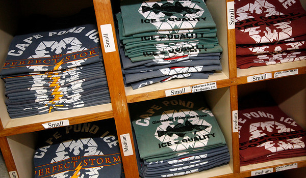 Allegra Boverman/Gloucester Daily Times. Some of the many kinds of t-shirts for sale at Cape Pond Ice at the Commercial Street headquarters in Gloucester.